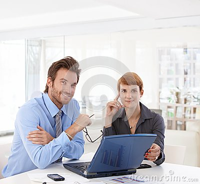 Young businesspeople working at office
