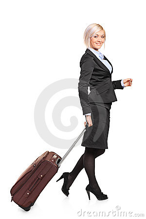 Young businesswoman carrying a luggage