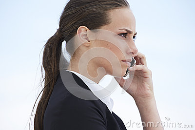 Young businesswoman on cellphone Stock Photo