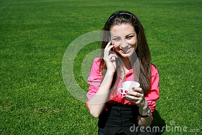 Young businesswoman drinking tea and talking