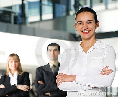 A young businesswoman in front of her colleagues