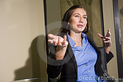 Young businesswoman gesturing