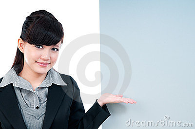 Young Businesswoman Gesturing At Blank Billboard