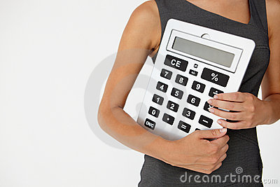 Young businesswoman with giant calculator