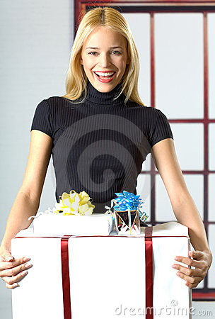 Young businesswoman with gifts