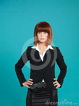 Young businesswoman, with gun in pocket