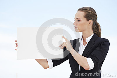 Young businesswoman holding blank sign