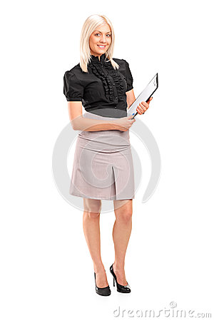 Young businesswoman holding a clipboard