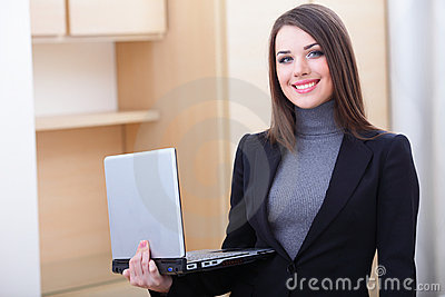 Young businesswoman holding laptop