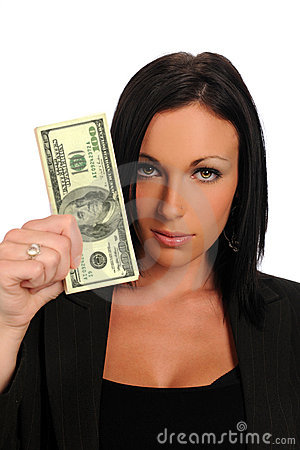 Young businesswoman holding a stuck of money