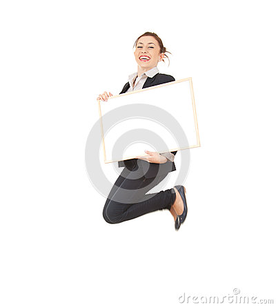 Young businesswoman jumping with empty board