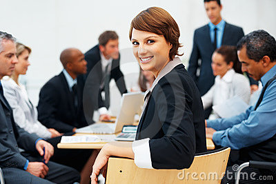Young businesswoman during meeting