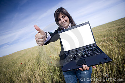 Young businesswoman outdoor with laptop