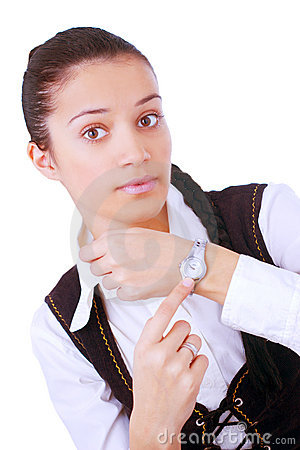 Young businesswoman pointing on her watch