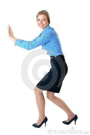 Young businesswoman push imaginary wall, isolated