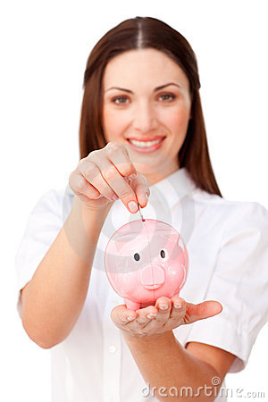 Young businesswoman saving money in a piggybank