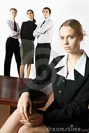 Young businesswoman or secretary and three business persons