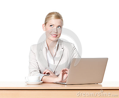 Young businesswoman sitting with cup of coffee