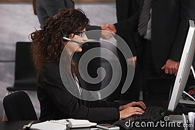 Businesswoman using desktop compter