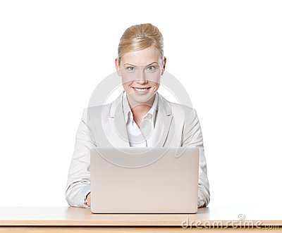Young businesswoman sitting at a desk with laptop