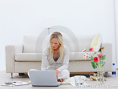 Young businesswoman sitting and  working on laptop