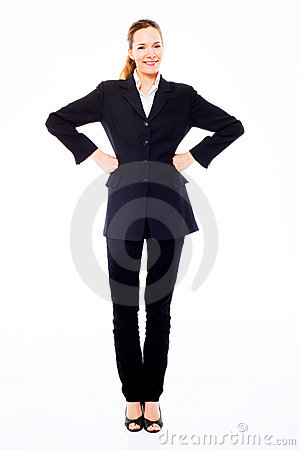 Young businesswoman standing with arms akimbo