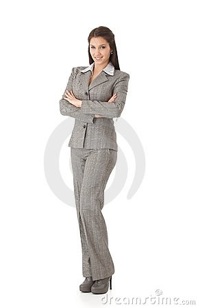 Young businesswoman standing arms crossed smiling