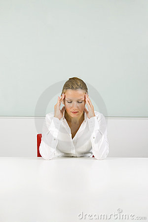 Young businesswoman in stress