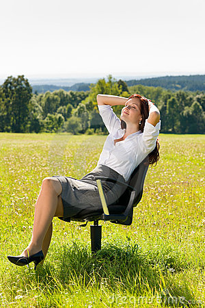 Young businesswoman sunny meadow relax on armchair