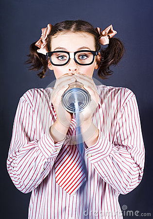 Young Businesswoman Talking On Homemade Can Phone