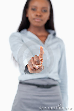 A young businesswoman touching an invisible screen