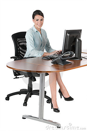 Young businesswoman typing at computer, isolated