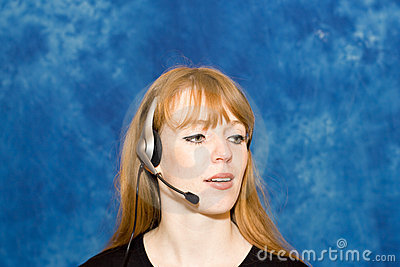 Young businesswoman using headset