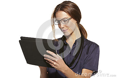 Young businesswoman using a tablet, smiling Stock Photo