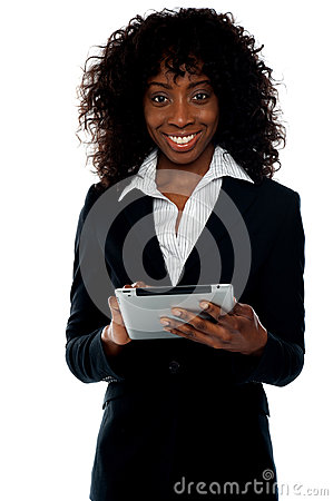 Young businesswoman using wireless tablet pc