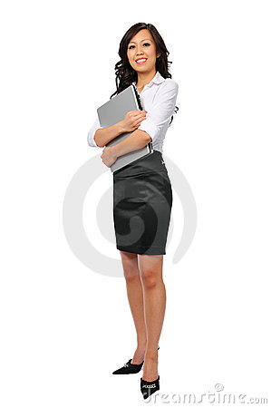 Free Young Businesswoman With Laptop Standing Stock Photography - 6045392