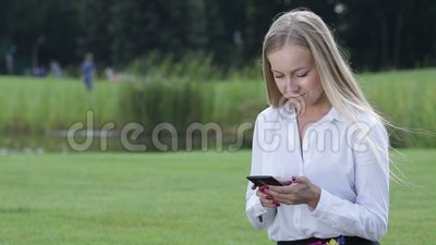 Young businesswoman working with cellphone outdoor stock video