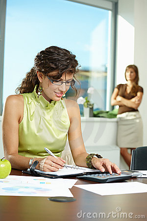 Young businesswoman writing notes