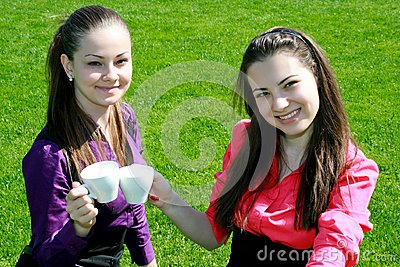 Young businesswomen drinking tea and talking
