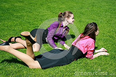 Young businesswomen relaxing on the grass