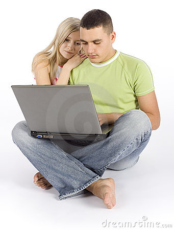 Young busy couple with laptop
