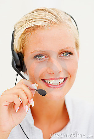 Young call centre employee speaking over headset