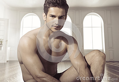 Young calm muscular man in luxury place Stock Photo
