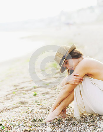 Free Young Calm Woman Relax Sitting On A Sand Sea Beach, Romantic Foggy Morning. Stock Image - 65235541