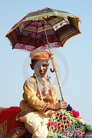 Young cameleer preparing to take part at camel decoration competition at cattle fair in Pushkar,India Editorial Stock Photo