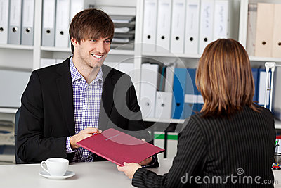 Young Candidate Looking At Businesswoman Taking Interview