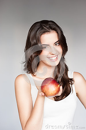 Young casual caucasian girl with red apple
