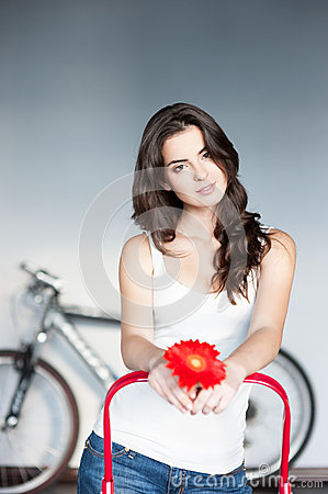 Young casual caucasian girl with red flower