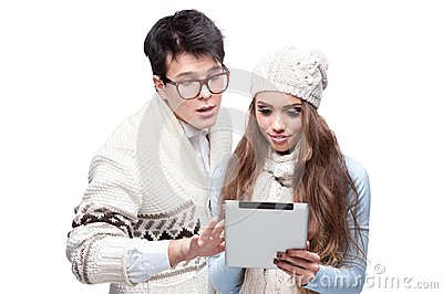 Young casual couple using tablet