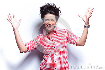 Young casual excited woman screaming
